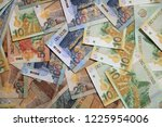 stack of different peruvian sol ... | Shutterstock . vector #1225954006