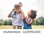 happy african family having fun ... | Shutterstock . vector #1225961323