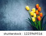 tulips are placed on a wooden... | Shutterstock . vector #1225969516