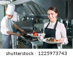 restaurant kitchen. waiter with ... | Shutterstock . vector #1225973743