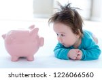 baby boy with a piggy bank in... | Shutterstock . vector #1226066560