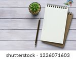 notebook on white wooden table... | Shutterstock . vector #1226071603