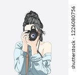 a woman holds a stylish camera... | Shutterstock .eps vector #1226080756