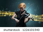 young male musician playing on... | Shutterstock . vector #1226101540