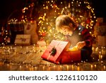 christmas child open present... | Shutterstock . vector #1226110120