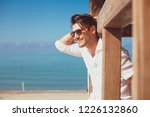 young smiling happy man on... | Shutterstock . vector #1226132860