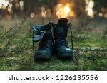 hiker old black boots standing...   Shutterstock . vector #1226135536