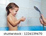 beautiful little girl taking a...   Shutterstock . vector #1226139670