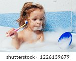 beautiful young girl bathes in...   Shutterstock . vector #1226139679