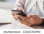 men using smart phone.... | Shutterstock . vector #1226142493