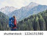 young woman traveler in alps... | Shutterstock . vector #1226151580