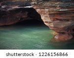 Apostle Islands National Lakeshore in Ashland and Bayfield counties, northern Wisconsin, Lake Superior. View of beautiful cliffs and sediment layers on the edge of the water.