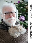 Senior Man And His Cat In Fron...