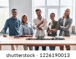 happy business partners. group... | Shutterstock . vector #1226190013