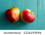 Two Apples On Blue Wooden...