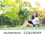 young woman sitting daydreaming ... | Shutterstock . vector #1226196349