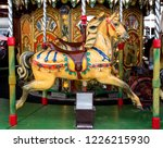 colorful horses on carousel | Shutterstock . vector #1226215930