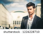 man in suit and white shirt... | Shutterstock . vector #1226228710
