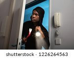 portrait of a thief in hooded...   Shutterstock . vector #1226264563