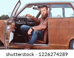bearded male dressed in brown... | Shutterstock . vector #1226274289