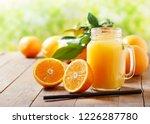 glass jar of fresh orange juice ... | Shutterstock . vector #1226287780