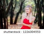 woman in red dress in fall... | Shutterstock . vector #1226304553