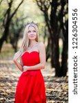 woman in red dress in fall... | Shutterstock . vector #1226304556
