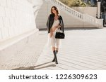 young stylish woman walking in... | Shutterstock . vector #1226309623