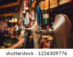 barman hands pouring a lager... | Shutterstock . vector #1226309776