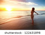 a young woman stands on the... | Shutterstock . vector #122631898