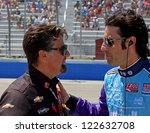 MILWAUKEE, WI - JUNE 16 : Indycar Race Driver Dario Franchitti talks to team owner Michael Andretti at the Milwaukee Mile Indyfest, Milwaukee, WI. June 16, 2012 - stock photo