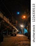 dark and eerie urban city alley ...   Shutterstock . vector #1226330113