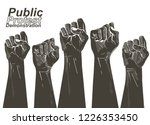 people raised hands fist air... | Shutterstock .eps vector #1226353450