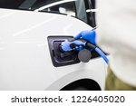 charging cable plugged into... | Shutterstock . vector #1226405020