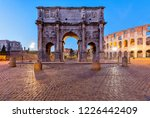 Small photo of Arch of Constantine - A dusk view of south side of Constantine's Arch, standing at between the Colosseum, right, and the Roman Forum, left. Rome, Italy.