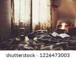 cozy winter morning with cup of ... | Shutterstock . vector #1226473003