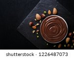 chocolate swirl with nuts in... | Shutterstock . vector #1226487073