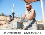man making brick from concrete... | Shutterstock . vector #1226504146