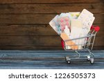 shopping cart with medication... | Shutterstock . vector #1226505373