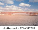 red steel bridge crossing ocean ... | Shutterstock . vector #1226506990