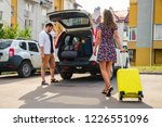 couple put bags in car trunk | Shutterstock . vector #1226551096