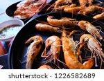shrimp burnt in electric pan | Shutterstock . vector #1226582689