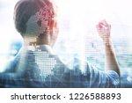 3d earth hologram on blurred... | Shutterstock . vector #1226588893