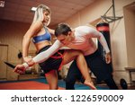 female person practicing knee... | Shutterstock . vector #1226590009