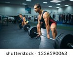 two weightlifters doing... | Shutterstock . vector #1226590063