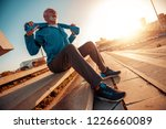 athletic senior man running in... | Shutterstock . vector #1226660089
