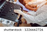 Gynecologist Performing Breast...
