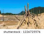 dry alpine reservoir | Shutterstock . vector #1226725576