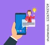 human hand holding smartphone... | Shutterstock .eps vector #1226743729
