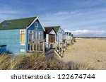 beach huts and boats in sand...